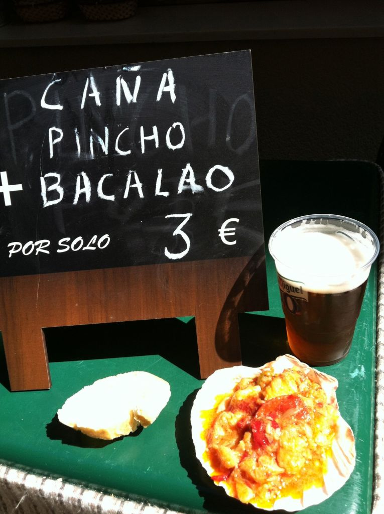 Thats a pint of beer and a huge portion of stewed cod and tomatoes for three euro. Awesome.