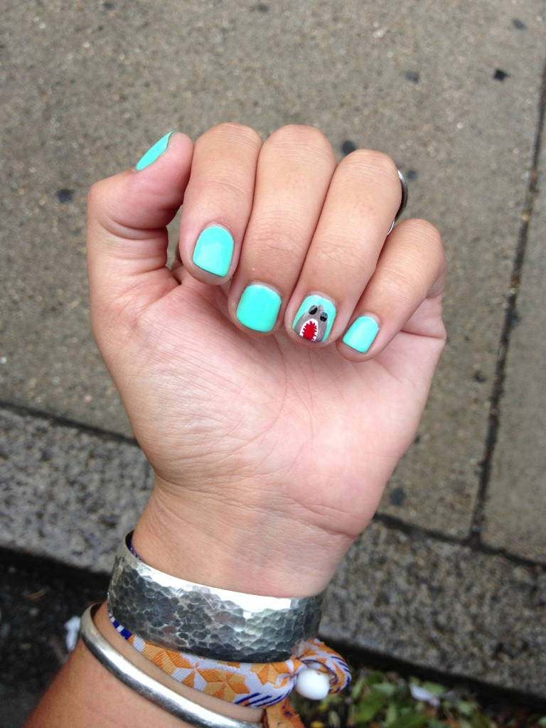 look, guys, she even did her nails for Shark Week.  She's intense.